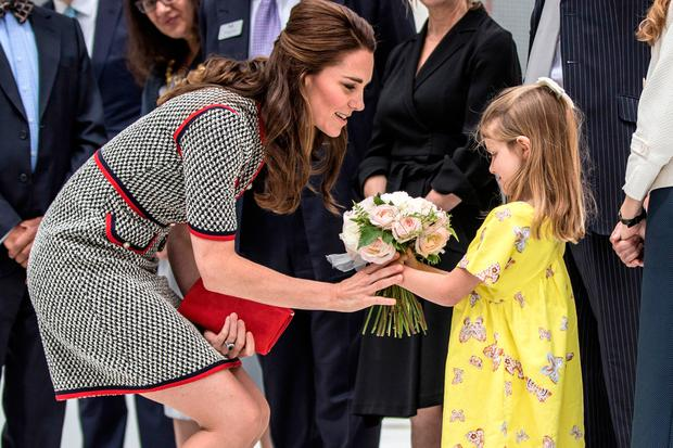 Catherine, Duchess of Cambridge receives flowers from six year old Lydia Hunt the daughter of new director of the V&A museum and former Labour MP Tristram Hunt at Victoria & Albert Museum on June 29, 2017 in London, England