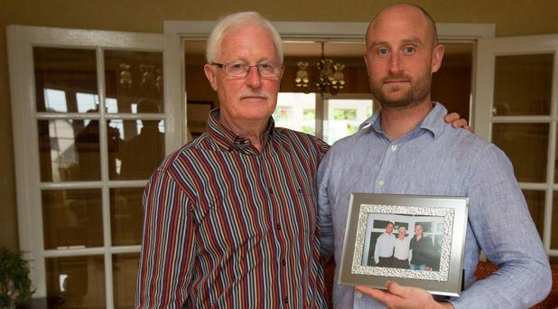 Paul Gerety (dad) and Andrew (brother) hold a picture of Mark Gerety who died in a taxi crash Photo: Mark Condren