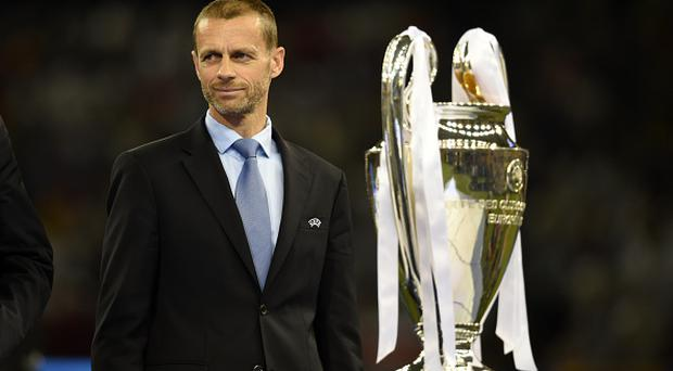 UEFA President Aleksander Ceferin is seen with the trophy after the UEFA Champions League final match between Juventus and Real Madrid at National Stadium of Wales on June 3, 2017 in Cardiff, Wales. (Photo by Etsuo Hara/Getty Images)