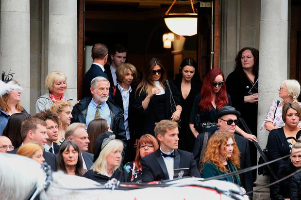 Mourners including Kym Marsh, Helen Worth and Kate Oates leave the funeral service of Martyn Hett