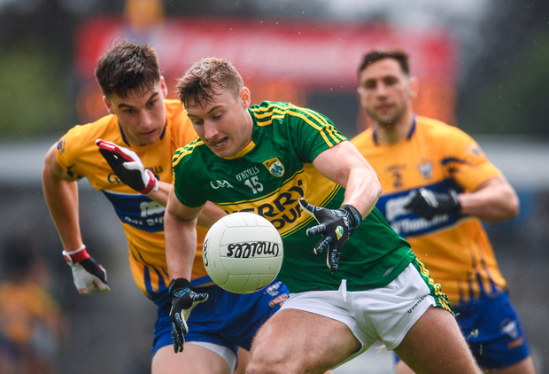 Kerry's James O'Donoghue with Clare's Shane Brennan in pursuit in their Munster SFC semi-final at Cusack Park, Ennis. Pic: Sam Barnes/Sportsfile