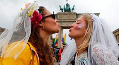 A couple kissing as people celebrate Germany's parliament legalising samesex marriage in front of the Brandenburg Gate in Berlin. Photo: Reuters