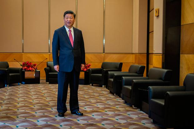 China's President Xi Jinping stands ahead of a meeting with Carrie Lam, Hong Kong's incoming chief executive (not pictured) in Hong Kong, China, July 1, 2017. REUTERS/Billy H.C. Kwok/Pool