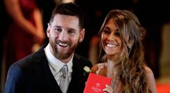 Newlyweds Lionel Messi and Antonella Roccuzzo pose for photographers after tying the knot in Rosario, Argentina, Friday, June 30, 2017. About 250 guests, including teammates and former teammates of the Barcelona star, attended the highly anticipated ceremony. (AP Photo/Victor R. Caivano)