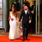 Argentine soccer player Lionel Messi and his wife Antonela Roccuzzo make an appearance for the press at their wedding in Rosario, Argentina, June 30, 2017. REUTERS/Marcos Brindicci TPX IMAGES OF THE DAY