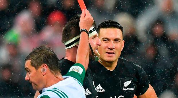 New Zealand All Blacks' Sonny Bill Williams (R) is shown the red card by referee Jerome Garces (L) beside captain Kieran Read during the second rugby union Test between the British and Irish Lions and the New Zealand All Blacks in Wellington on July 1, 2017. / AFP PHOTO / Marty MELVILLEMARTY MELVILLE/AFP/Getty Images