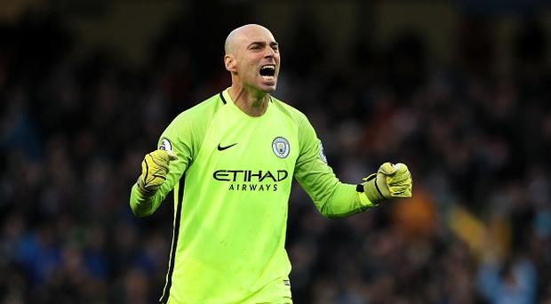 Willy Caballero of Manchester City celebrates his team's first goal which made the score 1-1 during the Premier League match between Manchester City and Liverpool at Etihad Stadium on March 19, 2017 in Manchester, England. (Photo by Matthew Ashton - AMA/Getty Images)