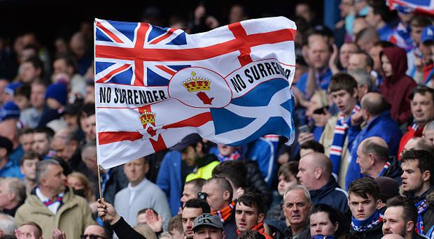 A Rangers fan flies a flag during the Ladbrokes Scottish Premiership match between Rangers and Celtic at Ibrox Stadium on April 29, 2017 in Glasgow, Scotland. (Photo by Mark Runnacles/Getty Images)