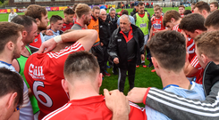 Cork manager Peadar Healy speaks to his players after the Munster SFC semi-final against Tipperary. Photo: Matt Browne/Sportsfile
