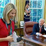 Caitriona Perry reacts as US President Donald Trump speaks to her in the Oval Office