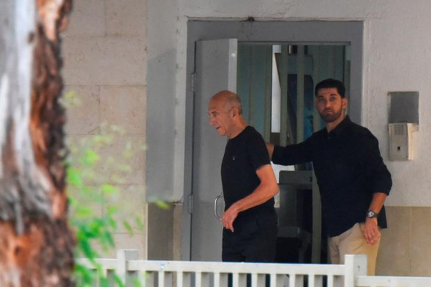 Former Israeli Prime Minister Ehud Olmert walks out of the prison door as he is released from prison after a parole board decided to cut his sentence by a third, at Maasiyahu prison near Ramle, Israel July 2, 2017. Walla!news/Rubi Kastro via REUTERS