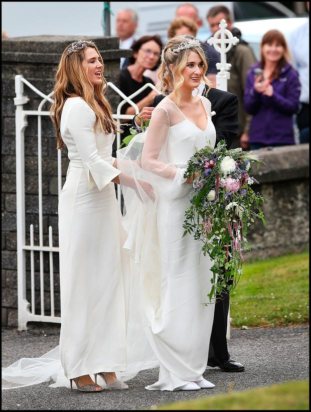 The bride Camilla Campion-Awwad arriving with her sister Aysha Campion-Awwad who was a bridesmaid at the Sacred Heart Chuch in Glengarriff where the wedding took place. PIc Steve Humphreys 1st July 2017