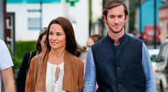 Pippa Middleton taking a stroll with husband James Matthews through the village of Glengarriff for her friend Camilla Campion-Awwad's wedding. Picture: Steve Humphreys