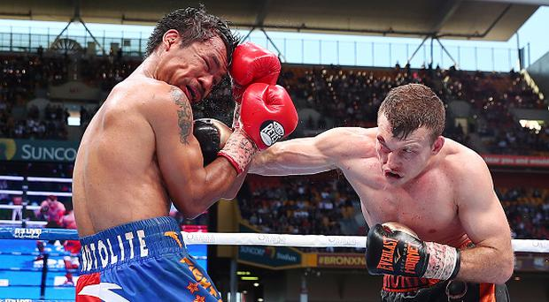 Jeff Horn of Australia punches Manny Pacquiao of the Philippines during the WBO World Welterweight Title Fight at Suncorp Stadium on July 2, 2017 in Brisbane, Australia. (Photo by Chris Hyde/Getty Images)