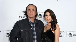 Director Quentin Tarantino and Singer/actress Daniella Pick attend the 'Reservoir Dogs' 25th Anniversary Screening during 2017 Tribeca Film Festival at Beacon Theater on April 28, 2017 in New York City. / AFP PHOTO / ANGELA WEISS (Photo credit should read ANGELA WEISS/AFP/Getty Images)