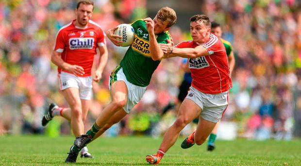 Donnchadh Walsh of Kerry in action against Sean Powter of Cork during the Munster GAA Football Senior Championship Final match between Kerry and Cork at Fitzgerald Stadium in Killarney, Co Kerry. Photo by Eóin Noonan/Sportsfile