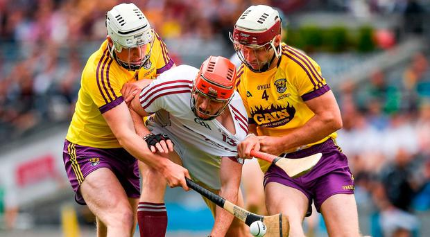 Conor Whelan of Galway of Galway in action against James Breen, left, and Liam Ryan of Wexford during the Leinster GAA Hurling Senior Championship Final match between Galway and Wexford at Croke Park in Dublin. Photo by Ray McManus/Sportsfile