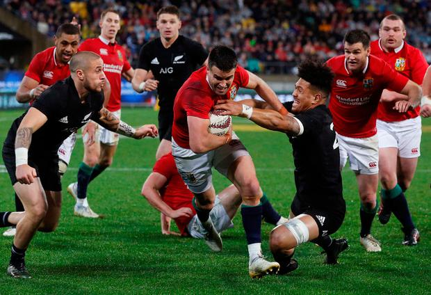 Conor Murray drives over the line to score the Lions' second try in Wellington on Saturday. Photo: REUTERS
