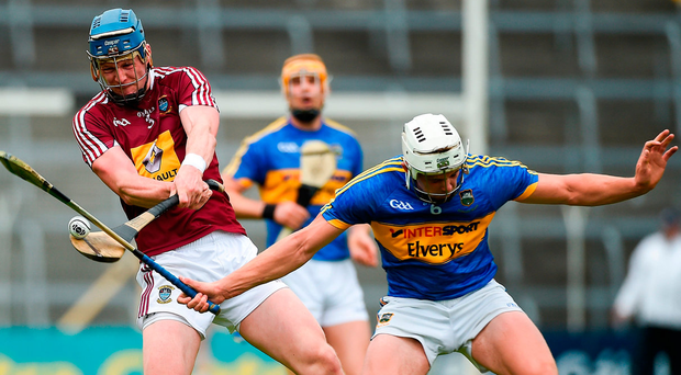Westmeath's Tommy Doyle is blocked down by Tipperary's Ronan Maher during their Round 1 qualifier at Semple Stadium. Photo: Sportsfile