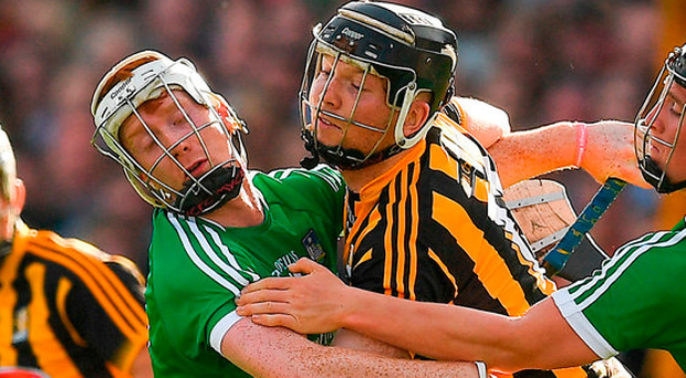 Walter Walsh of Kilkenny clears under pressure from Limerick's Cian Lynch during the GAA Hurling All-Ireland Senior Championship Round 1 match between Kilkenny and Limerick at Nowlan Park in Kilkenny. Photo: Sportsfile