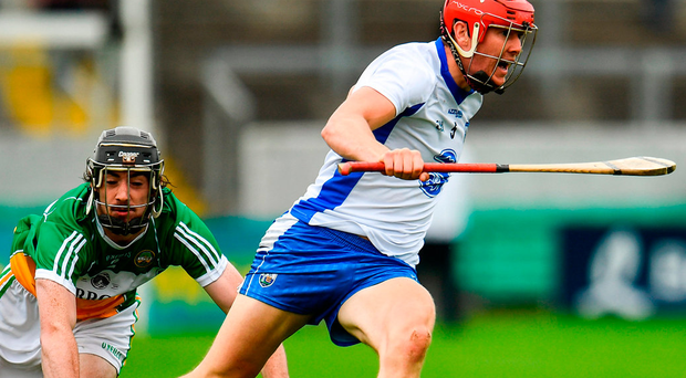 Waterford's Tadhg de Burca gets away from Ben Conneely of Offaly during their Qualifier match in Tullamore. Photo: Sportsfile