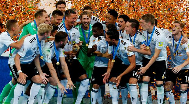 Germany celebrate with the trophy after winning the FIFA Confederations Cup. Photo: Grigory Dukor/Reuters