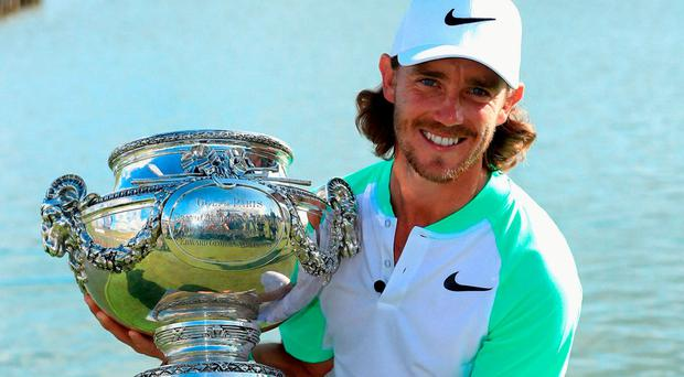 Tommy Fleetwood with the trophy after his victory in the Open de France. Photo by Andrew Redington/Getty Images