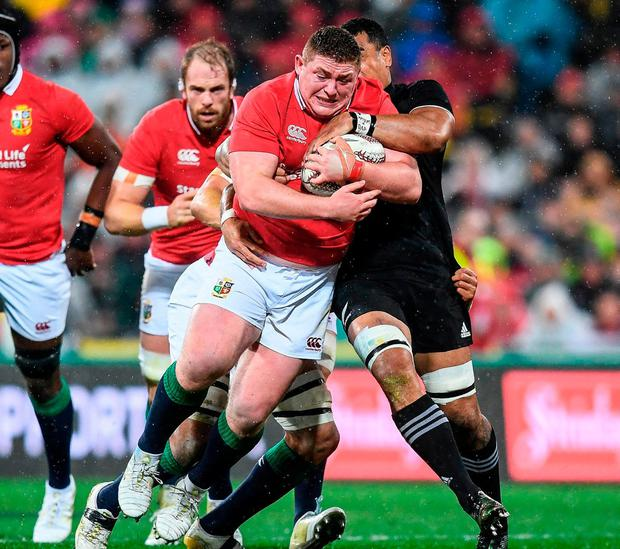 Tadhg Furlong is lifted off his feet as he is tackled by New Zealand's Jerome Kaino during the Second Test in Wellington. Photo by Stephen McCarthy/Sportsfile