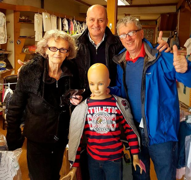 Jonathan Sexton's nana Brenda, uncle John, godfather Billy Keane and Martin the Mannequin celebrate the Lions' victory on Saturday in Brenda's shop