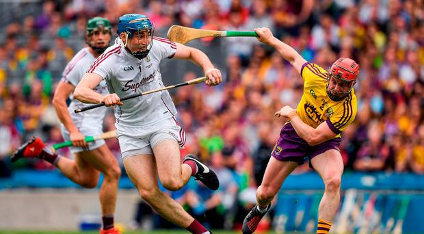 Conor Cooney of Galway in action against Willie Devereux of Wexford during the Leinster GAA Hurling Senior Championship Final match between Galway and Wexford at Croke Park in Dublin. Photo by Ray McManus/Sportsfile