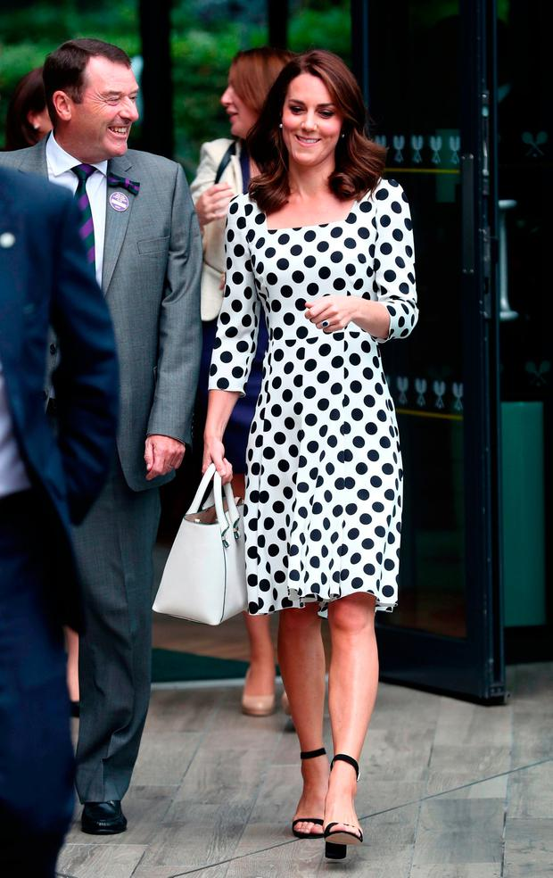 Philip Brook Chairman of the All England Lawn Tennis Club chats with Britain's Catherine, Duchess of Cambridge (R) as she visits The All England Lawn Tennis Club in Wimbledon, south-west London, on July 3, 2017 on the first day of the 2017 Wimbledon Championships. / AFP PHOTO / POOL / Gareth FULLER /