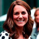 Britain's Catherine, Duchess of Cambridge, smiles as she meets former players, servicemen and servicewomen as she visits The All England Lawn Tennis Club in Wimbledon, south-west London, on July 3, 2017 on the first day of the 2017 Wimbledon Championships. / AFP PHOTO / POOL / Gareth FULLER /