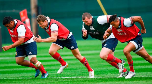 Mako Vunipola (left) and Jack McGrath (centre) – seen here in training alongside Dan Biggar, Anthony Watson and Ben Te'o – look to be in a straight race for a spot in the front row in the final Test on Saturday. Photo: Ramsey Cardy/Sportsfile