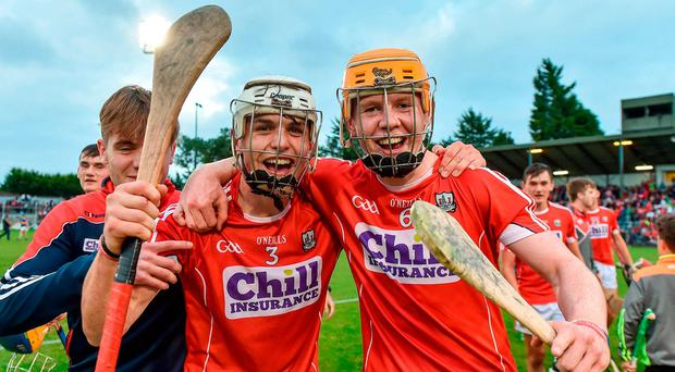 Sean O'Leary Hayes (left) and James Keating celebrate Cork's victory over Tipperary. Photo: Eóin Noonan/Sportsfile