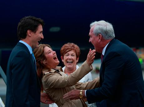 Canadian Prime Minister Justin Trudeau and his wife Sophie Grégoire-Trudeau are greeted by Canadian Ambassador to Ireland Kevin Vickers at Dublin Airport. Photo: Arthur Carron