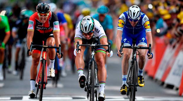 Slovakia's Peter Sagan (C) sprints to win ahead of Belgium's Greg Van Avermaet (L) and Ireland's Daniel Martin at the end of the 212,5 km third stage of the 104th edition of the Tour de France cycling race yesterday