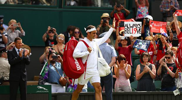 Roger Federer of Switzerland acknowledges the crowd as he walks onto court prior to the during the Gentlemen's Singles first round match against Alexandr Dolgopolov of Ukraine on day two of the Wimbledon Lawn Tennis Championships at the All England Lawn Tennis and Croquet Club on July 4, 2017 in London, England. (Photo by Michael Steele/Getty Images)