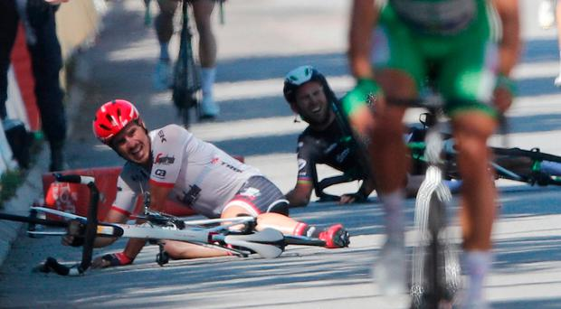 Germany's John Degenkolb, left, and Britain's Mark Cavendish crash. Image: AP Photo/Christophe Ena