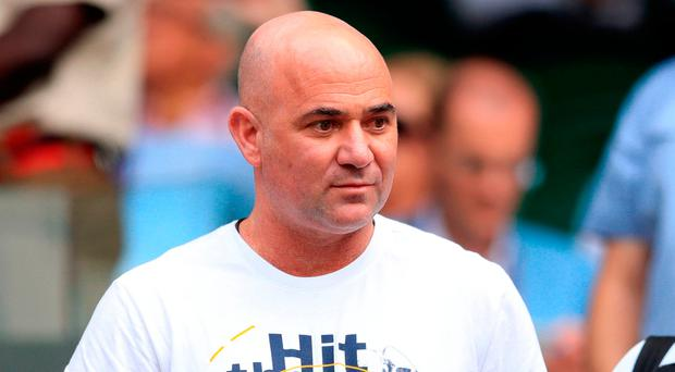 Andre Agassi takes his seat to watch Novak Djokovic. Photo credit: Adam Davy/PA Wire.
