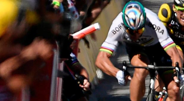 Slovakia's Peter Sagan (R) gives a kick of elbow and Great Britain's Mark Cavendish (L) falls near the finish line at the end of the 207,5 km fourth stage of the 104th edition of the Tour de France cycling race