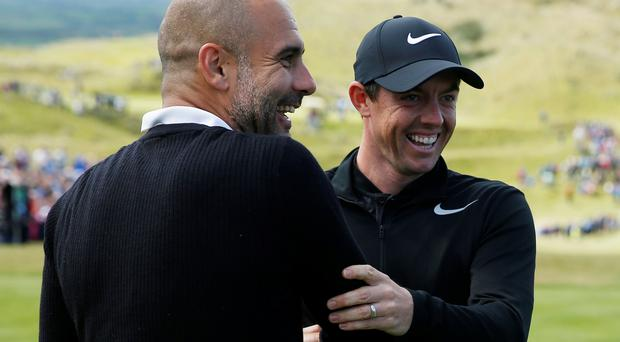 Pep Guardiola and Rory McIlroy share a joke at the Irish Open ProAm