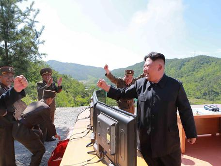 North Korean Leader Kim Jong-un reacts during the test-fire of intercontinental ballistic missile Hwasong-14 in this undated photo released by North Korea's Korean Central News Agency REUTERS