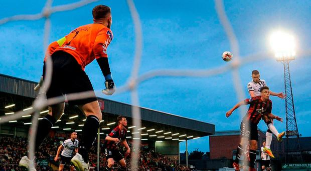 Ciaran Kilduff rises highest to score Dundalk's late winner at Dalymount. Photo by Sam Barnes/Sportsfile
