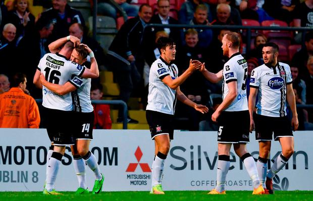 Dundalk's Ciaran Kilduff, left, celebrates with Dane Massey and team-mates after scoring his side's goal. Photo by Sam Barnes/Sportsfile
