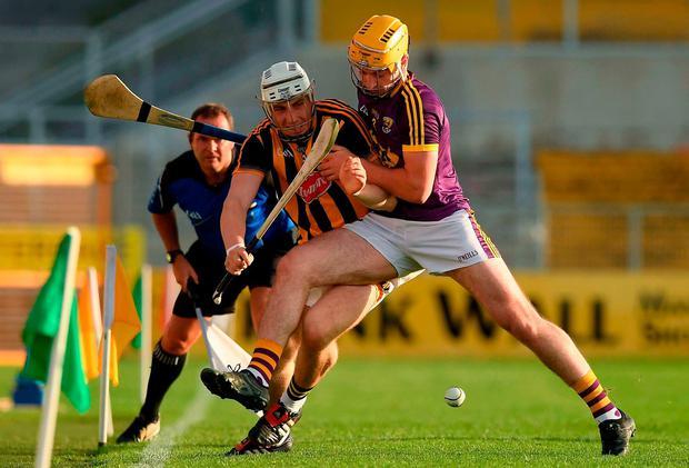 Kilkenny's Liam Blanchfield and Darren Byrne of Wexford battle for possession during the Bord Gais Energy Leinster GAA Hurling Under 21 Championship Final. Photo: Ray McManus/Sportsfile