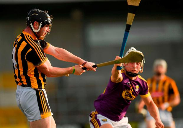 James Burke of Kilkenny clears under pressure from Cathal Dunbar. Photo: Ray McManus/Sportsfile