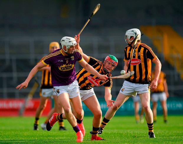 Rowan White keeps control after a challenge from Kilkenny's Pat Lyng. Photo: Ray McManus/Sportsfile
