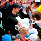 There's no doubting the main attraction in Portstewart as Rory McIlroy signs autographs for fans at yesterday's Pro-Am. Photo: Niall Carson/PA Wire