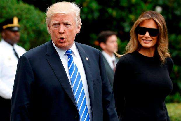 US President Donald Trump leaving the White House with his wife Melania for the G20 summit in Germany. Photo: Jonathan Ernst/Reuters