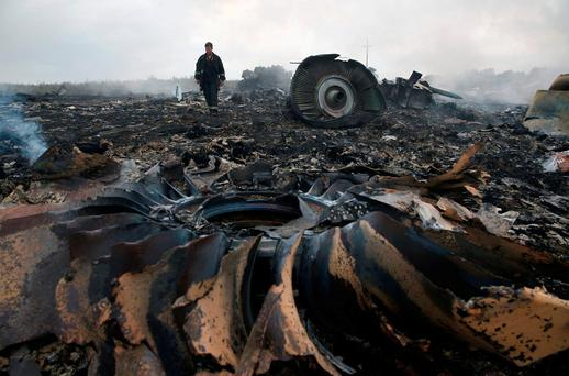 An emergency worker at the site of a Malaysia Airlines plane crash near the settlement of Grabovo in the Donetsk region